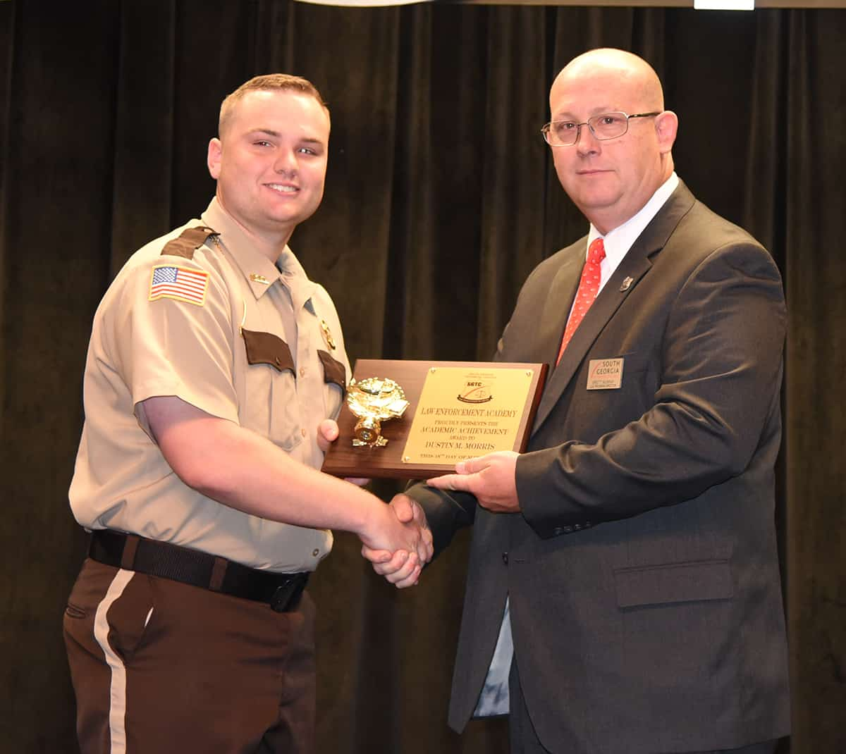 SGTC LEA Academy Director Brett Murray is shown above presenting Dustin Morgan Morris of Tifton with the Academic Achievement Award for the Class of 18-01.