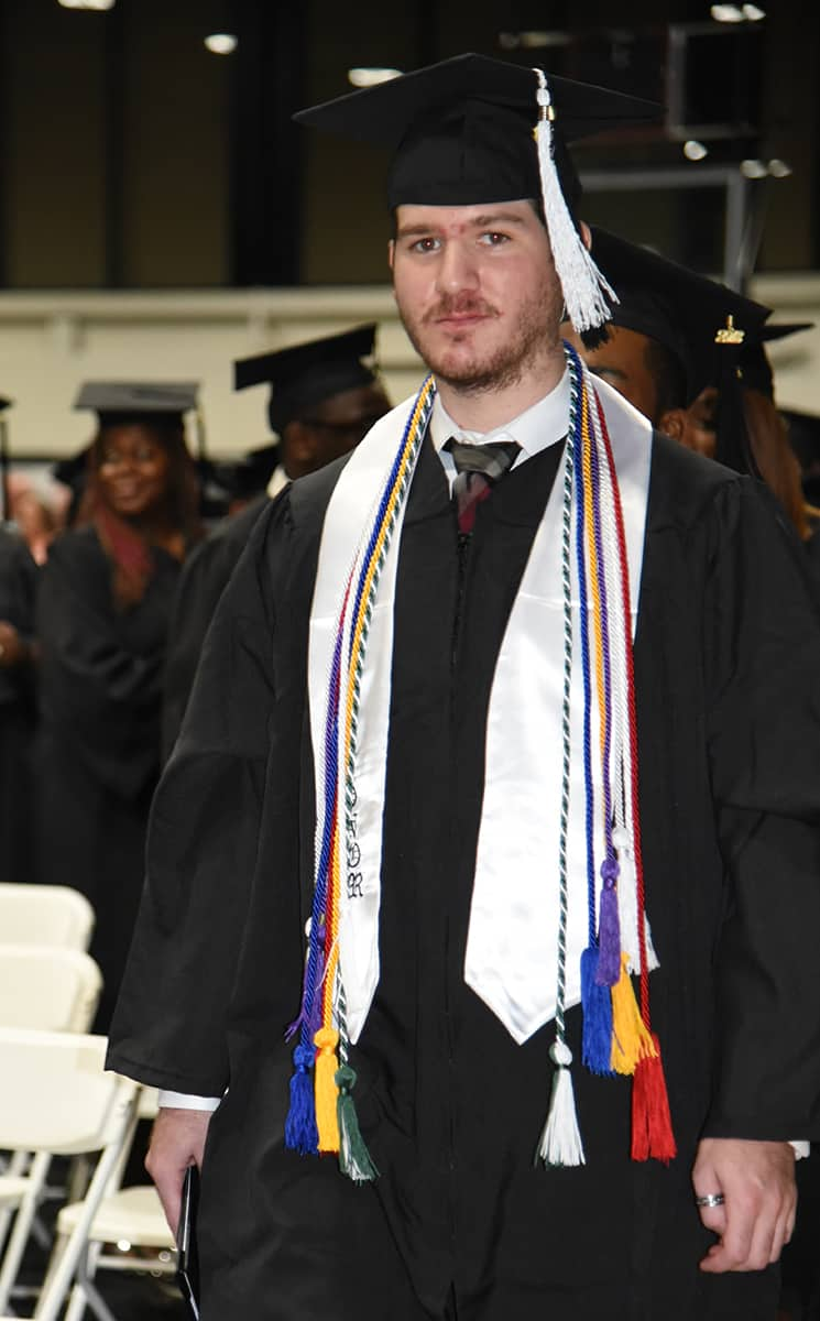 Dakata Hall of Cordele was awarded his Computer Support Specialist and Networking Specialist Diplomas at SGTC's Spring graduation.  He was an Honor Graduate as well as a member of the National Technical Honor Society, Phi Beta Lambda, Skills USA, and the Student Government Association.  He is shown with his white honor graduate stole as well as the white and purple cords, blue cords, red and white cords, and green and white cords for his different honors and recognitions.