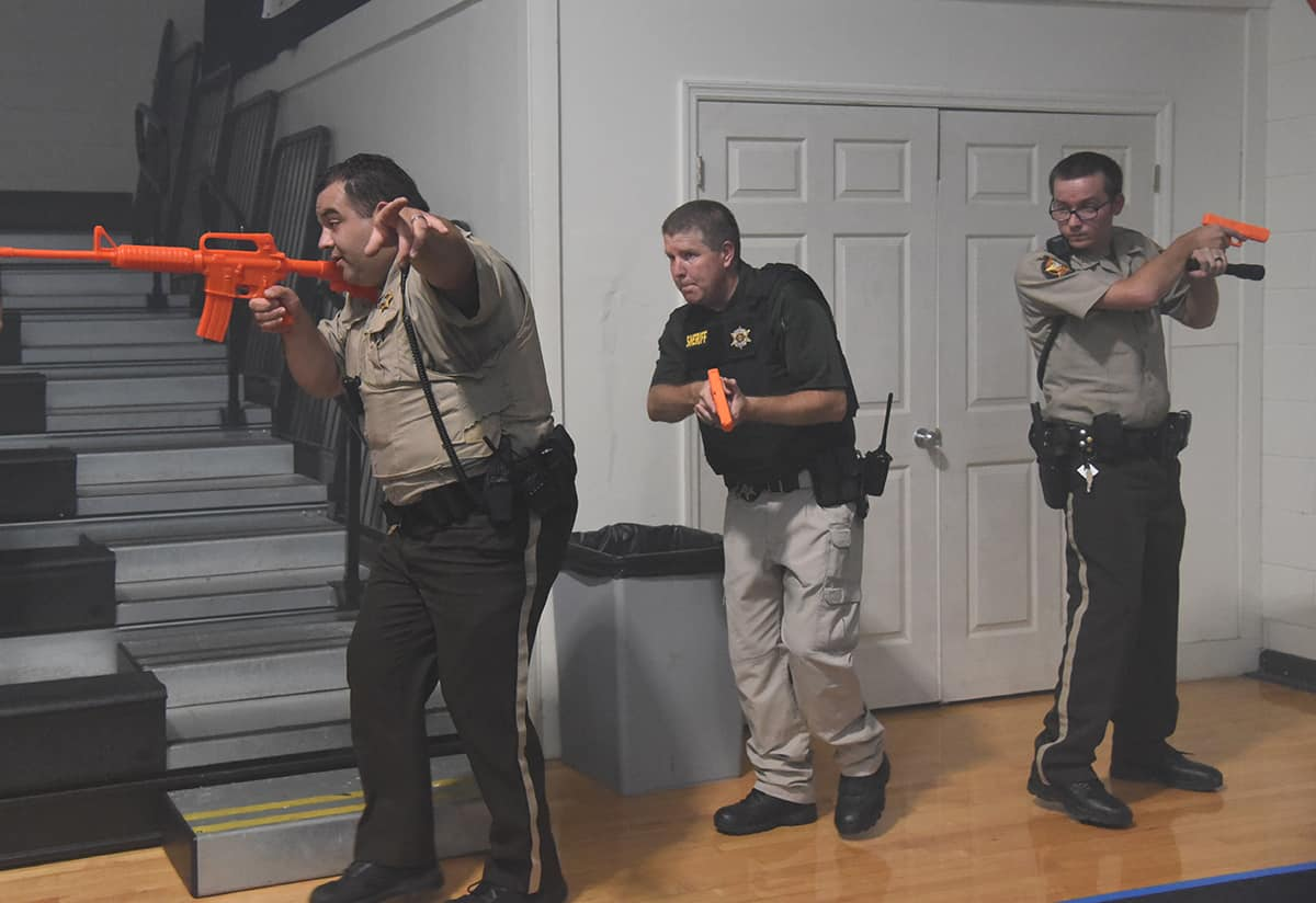Sumter County Sheriff Officers are shown doing a sweep of the gym during the mock incident.