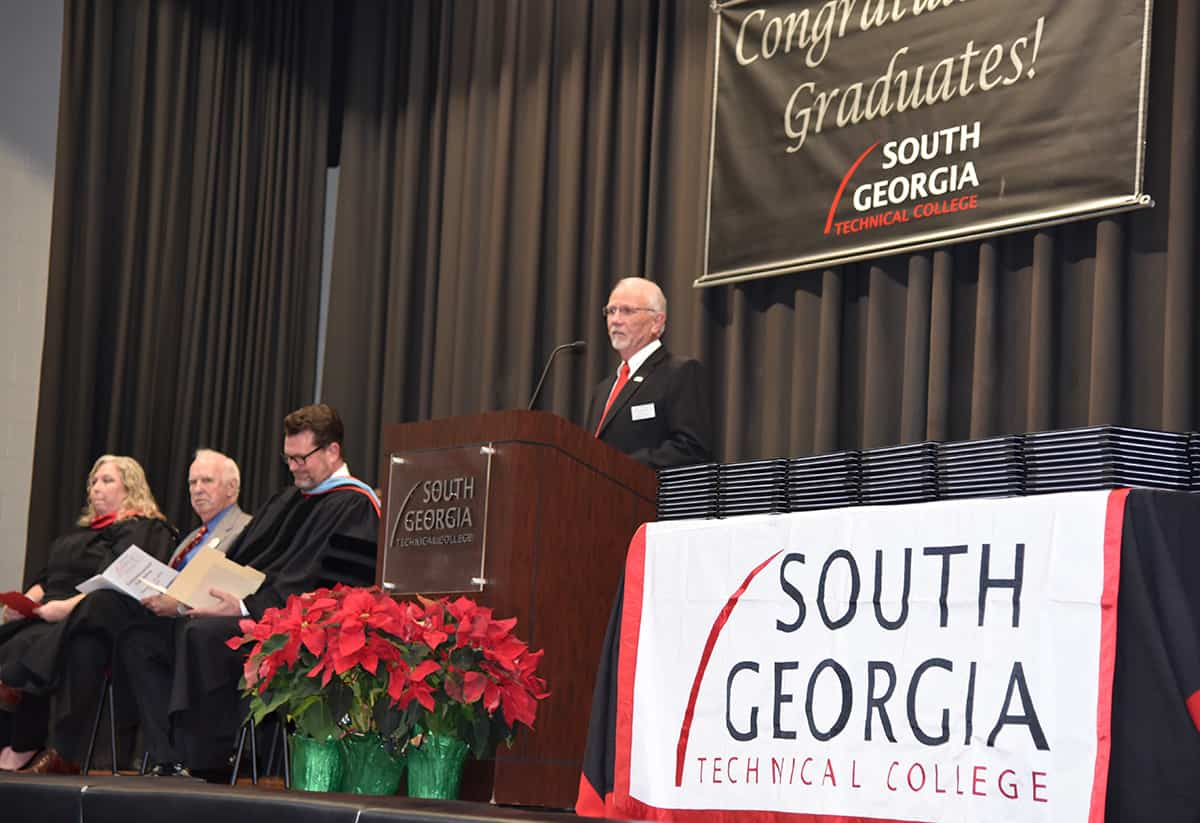 South Georgia Technical College Board of Director Chairman and SGTC Alumni Jake Everett is shown above introducing Criminal Justice Instructor Teresa McCook as the graduation speaker at the Fall 2018 ceremony.