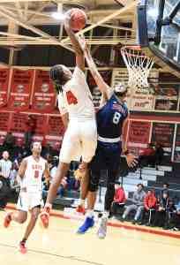 Denari Garrettt is shown going up for the dunk.