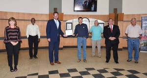 South Georgia Technical College President Dr. John Watford (third from left) is shown above presenting Tyler Beckon with the Kyle Glenn Holcombe Electrical Lineworker Scholarship certificate. Also shown (l to r) are SGTC Economic Development Assistant Tami Blount, SGTC Lineworker Instructor Sidney Johnson, Dr. Watford, Tyler Beckon, Lineworker instructor Bobby Baxley, SGTC Economic Development Director Paul Farr, and Electrical Lineworker instructor Dewey Turner.