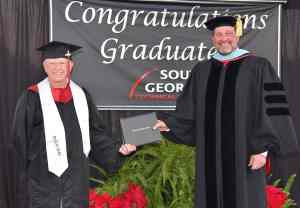 SGTC President Dr. John Watford is shown above (right) is awarded Jack Stanley of North Carolina, his associate degree in Electronics with honors. Jack graduated with a diploma from the program in 1967 and returned to get his associate degree online.