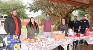 South Georgia Tech SGA students and advisors are shown setting up for the Valentine's Day Goodies & Giveaways in Gailey Park.