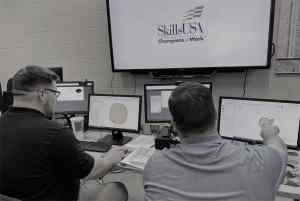 SGTC Precision Machining and Manufacturing State SkillsUSA Champions Patrick Hortman and Tison Smith are shown above preparing for the national SkillsUSA Additive Manufacturing competition.