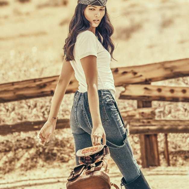 Women's Wrangler Born Ready Short Sleeve Retro Kabel Pastels Logo T-Shirt, $29.99; Women's Skinny Leg Overall, $69.99—both from Wrangler.com; Classic Bandana, $10—Urban Outfitters; Sbicca Over-the-Knee Boots, $138—Forever 21; bag—model's own.