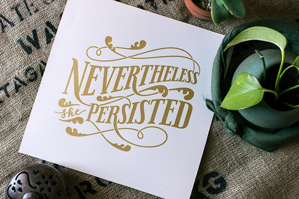 """""""Nevertheless, she persisted"""" gold ink screen print"""