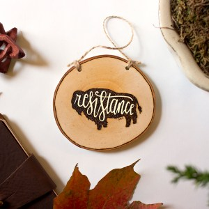 """Bison wood burned ornament with """"resistance"""" text"""