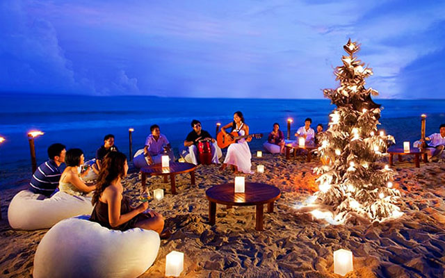 Group of young people celebrating Christmas and New Year near Lakshadweep beach
