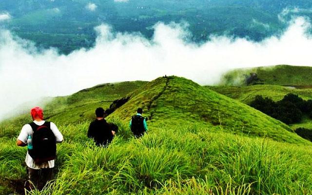 Three young people walking in the Araku valley