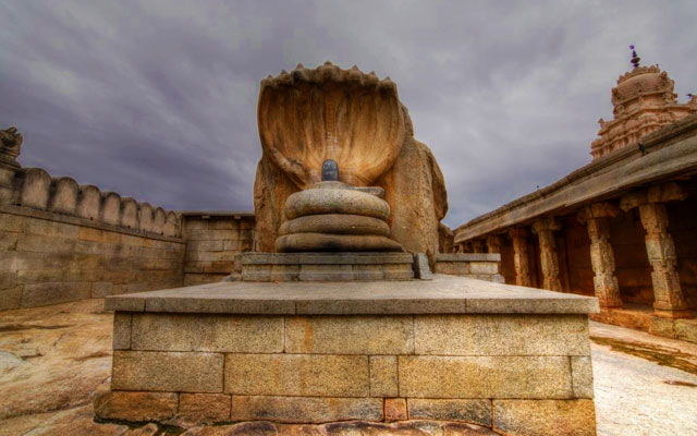 The hooded serpent Naaga shading the lingam sculpture in the Veerabhadra temple in Lepakshi in the Anantapur district of  Andhra Pradesh