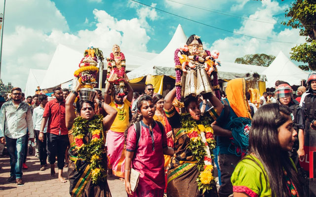 Female devotees carrying Milk pitcher on the ocassion of Thaipusam festival