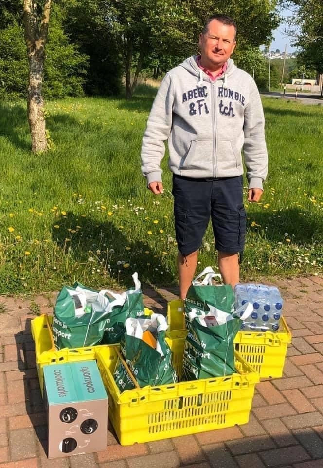 South Wales Argus: Mike Enea with some of the treats for the staff at the Grange on behalf of St Julian's Volunteer Group