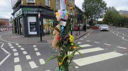 Flowers and notes of condolence have been left at the scene of the collision which claimed the cyclist's life