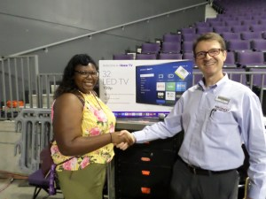Grand Canyon University (GCU) Club & Community Fair Raffle Prize Winner Lauren with her new smart TV!