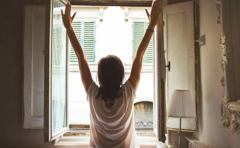 woman fearlessly opening window