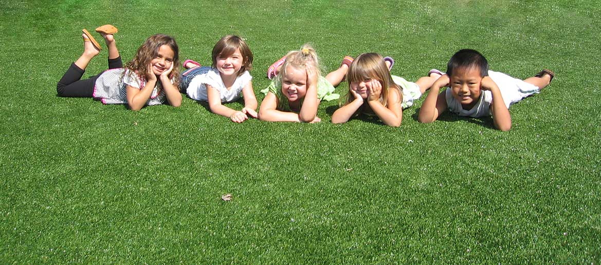 Kids on Playground Grass
