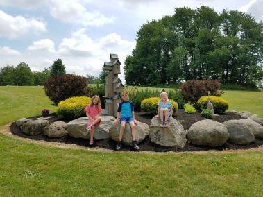 Kids posing at a flower garden
