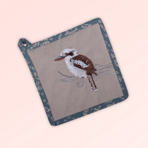 Pot holder, insulated. A square pot holder made with organic cotton featuring an embroidered Kookaburra, trimmed with a blue grey cotton fabric with a hang tie