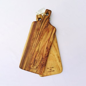 Two large wooden paddle chopping boards
