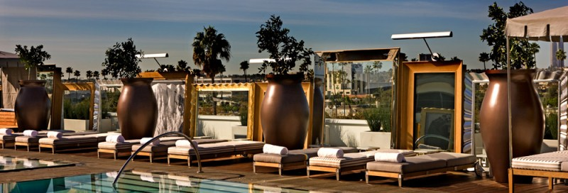 Aren't these mirrors surrounding the pool a fun way to create a cozy space?  photo via SLSHotels.com
