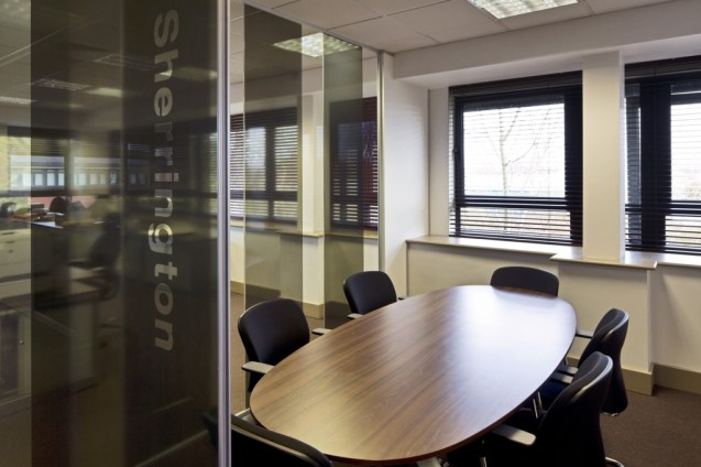 Image of Ogilvy 4D glass partition meeting room with opaque glass vinyl signage