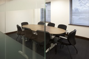 Image of The Order of St Johns Trust meeting room with glass dividing wall