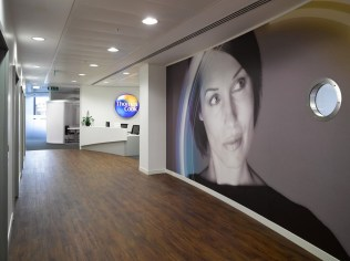 Image of Thomas Cook HQ curved walls, porthole windows and digital wallpaper