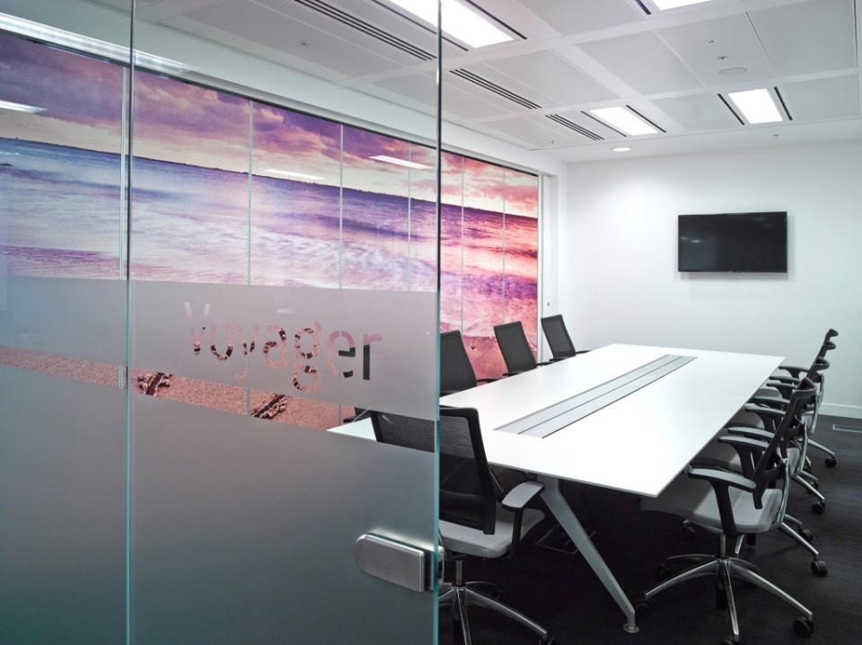 Image of Thomas Cook HQ meeting room with glass wall with opaque vinyl and digital wall graphics