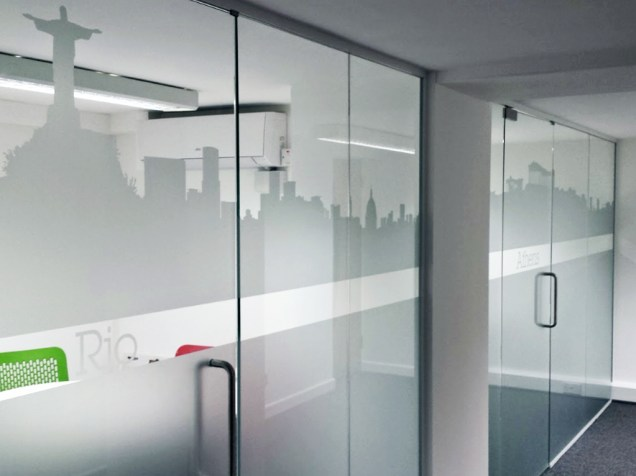Image of Lane 4 glass office divider wall and doors with frosted vinyl graphics