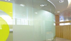 Image of a curved glass office wall partition