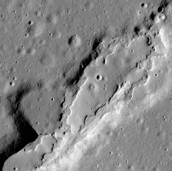 This photo from the Lunar Reconnaissance Orbiter Camera shows lava flows that spread across the floor of a large, collapsed area. The flows have few impact craters and steep sides, suggesting the eruptions were recent.