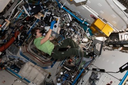 Anne McClain takes photographs for the Protein Crystal Growth-16 experiment, which was brought to the outpost aboard the NG-10 Cygnus spacecraft. Photo Credit: NASA