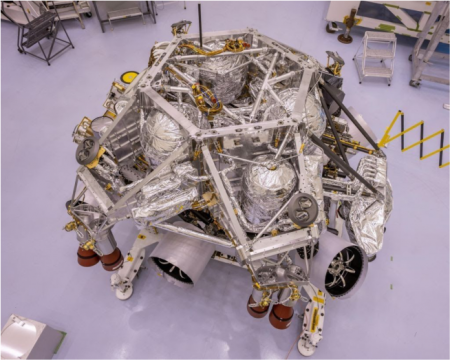 This image of the rocket-powered descent stage sitting on top of NASA's Perseverance rover was taken in a clean room at Kennedy Space Center on April 29, 2020. Credit: NASA