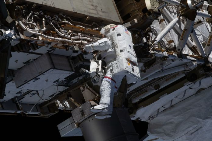 NASA astronaut Mike Hopkins works on the P4 truss during the first spacewalk of 2021. During their second spacewalk, he and astronaut Victor Glover worked to finish a battery upgrade project that was started four years ago. Credit: NASA