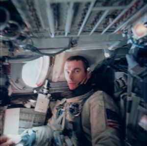 An exhausted Gene Cernan can barely manage a grimace for Tom Stafford's camera after completing his spacewalk on Gemini IX-A. Had the hands of fate played out a little differently, this seat might instead have been occupied by Charlie Bassett. (Credits: NASA)