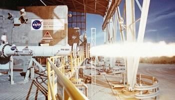 Test firing an American Rocket Company (AMROC) hybrid rocket motor at NASA's Stennis Space Center in 1994 (Credits: NASA).