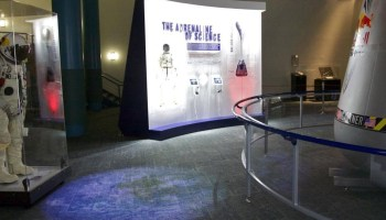 The travelling Red Bull Stratos Exhibit featuring Baumgartner's pressure suit and capsule (Credits: Red Bull Stratos).