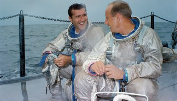 Dick Gordon (left) and Pete Conrad await the start of an emergency water egress training exercise in the Gulf of Mexico in July 1966 (Credits: NASA).