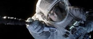 """Gravity"" astornaut Matt Kowalski (George Clooney) reaches to secure his tether during EVA (Credits: Warner Bros.)."
