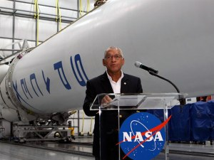 NASA Administrator hailed the conclusion of the agency's Commercial Orbital Transportation Services (COTS) program in a news conference at NASA's headquarters in Washington D.C. Photo Credit: NASA
