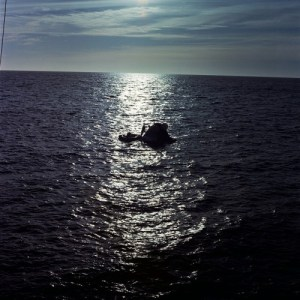 In the beautifully calm waters of the Pacific, the command module of the final Skylab crew bobs gently after 84 days in space. (Credits: Joachim Becker/SpaceFacts.de).