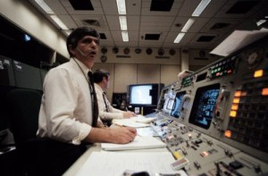 Horror and shock is etched on the faces of Flight Directors Jay Greene (foreground) and Lee Briscoe in the aftermath of the explosion (Credits: NASA).