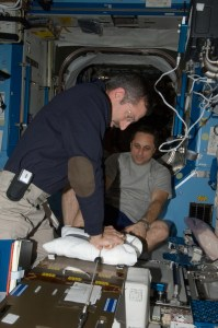 NASA astronaut Dan Burbank and Russian cosmonaut Anton Shkaplerov participate in a Crew Health Care System medical contingency drill in the Destiny laboratory of the International Space Station. This drill gives crewmembers the opportunity to work as a team in resolving a simulated medical emergency onboard the space station (Credits: NASA).