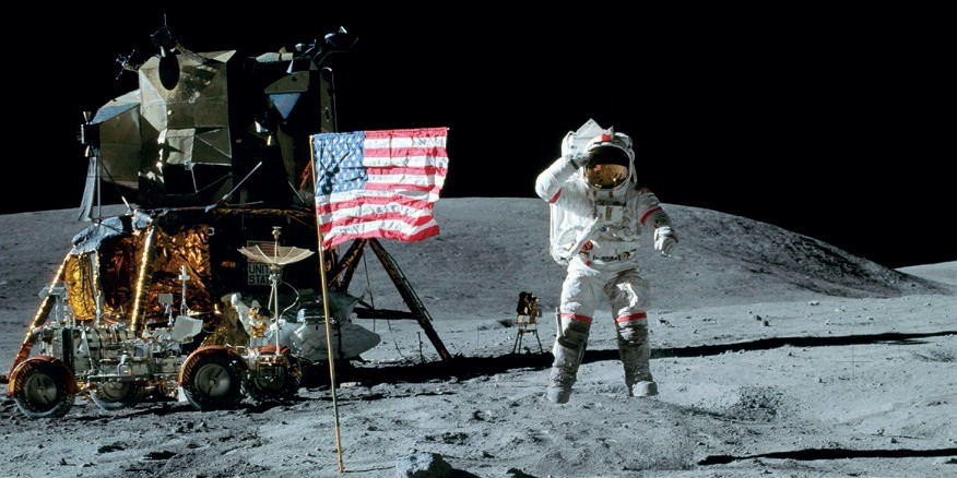 John Young (pictured here while saluting the flag on Apollo 16's first EVA) received the news about the approval of the Shuttle program while walking on the Moon. He would later become Commander of  the Space Shuttle inaugural flight (Credits: NASA).