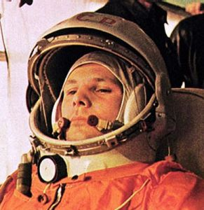 Clad in his orange space suit, Yuri Gagain appears pensive in this image recorded during his journey to the launch pad on 12 April 1961 (Credits: Roscosmos).