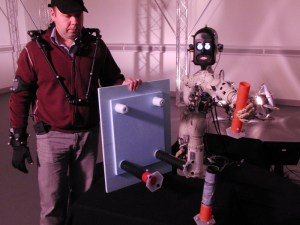 Chris and BERT-2 cooperate to build a table (Credits: Bristol Robotics Laboratory).