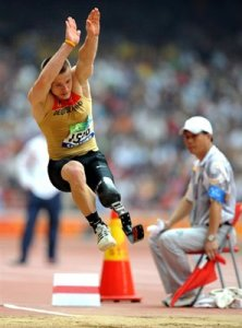 Wojtek Czyz jumps in a classification event for the 2008 Beijing Paraolimpics Games.