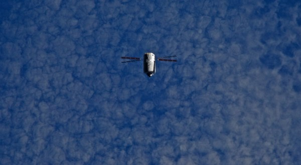 ATV flying under International Space Station, Credits: NASA/ESA