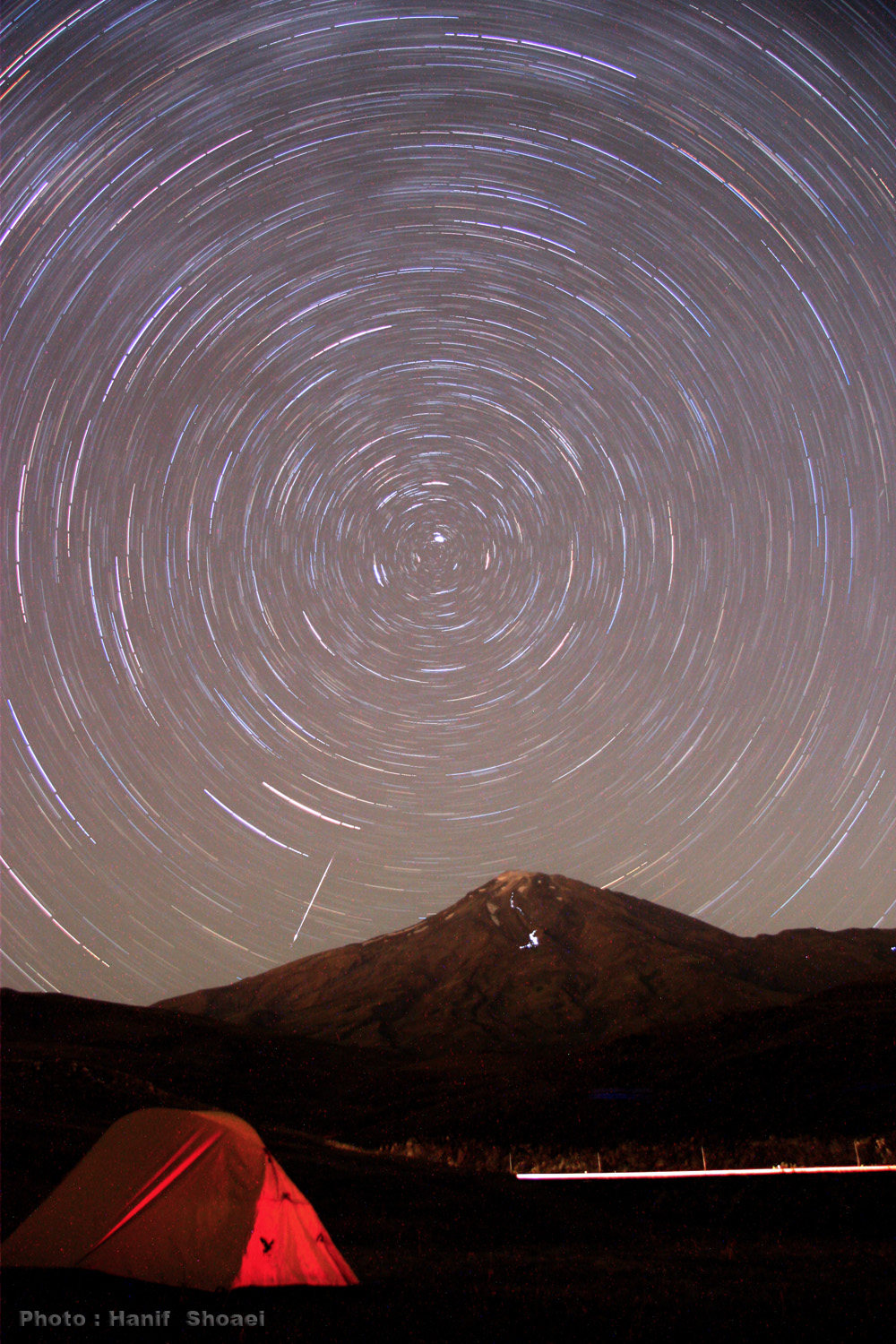Damavand Mount(The highest peak of iran) & the mountaineers Head lights trail , Star Trail & a meteor Canon 40D , 90 min exposure - Hanif Shoae - Poloor, Iran